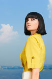 Girl with bob hairstyle over blue sky Stock Photos