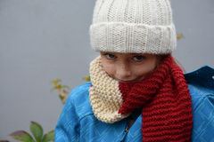 Girl with bobble hat. Freezing girl with new white bobble hat Royalty Free Stock Photo