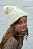 Girl with bobble hat Stock Images