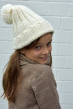 Girl with bobble hat Royalty Free Stock Image