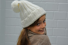 Girl with bobble hat. Girl with new white bobble hat Stock Photo