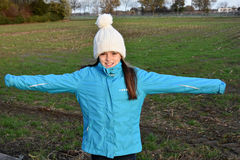 Girl with bobble hat. Girl with new white bobble hat Royalty Free Stock Image