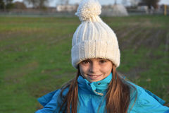 Girl with bobble hat. Girl with new white bobble hat Royalty Free Stock Photos