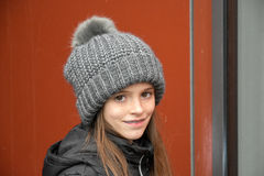 Girl with bobble hat. Portrait of a teenage girl with bobble hat and dental braces Royalty Free Stock Photos