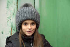 Girl with bobble hat. Portrait of a teenage girl with bobble hat and dental braces Stock Image
