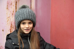 Girl with bobble hat. Portrait of a teenage girl with bobble hat and dental braces Stock Photos