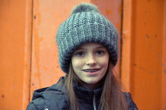 Girl with bobble hat. Portrait of a teenage girl with bobble hat and dental braces Royalty Free Stock Image