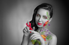 Girl with body art,. Girl wigh flower body art. Black and white, partly color Stock Images