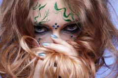 Girl with bodyart Stock Images