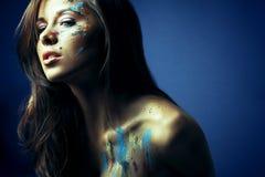 Girl with bodyartposing on blue Royalty Free Stock Photos