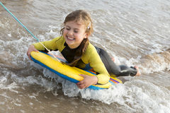 Girl on Bodyboard Royalty Free Stock Photo