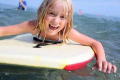 Girl bodyboarding royalty free stock photo