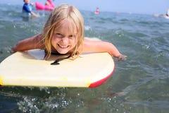 Girl bodyboarding royalty free stock photography