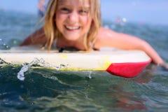 Girl bodyboarding royalty free stock photos