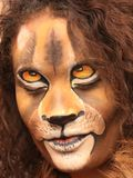 Girl with lion face bodypaint. Girl bodypainted as lion in the dutch city amsterdam to promote the world wildlife day Stock Image