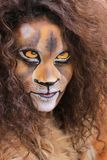 Girl with lion face bodypaint. Girl bodypainted as lion in the dutch city amsterdam to promote the world wildlife day Stock Photo