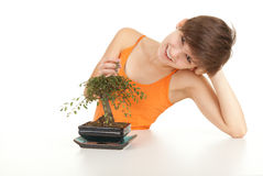 Girl with bonsai tree Royalty Free Stock Images