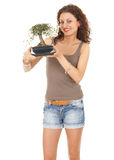 Girl with bonsai tree Stock Image