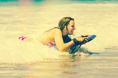 Girl Boogie Boarding Stock Photo
