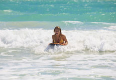 Girl boogie boarding the waves Royalty Free Stock Photography