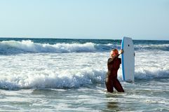 Girl with a boogieboard Stock Images
