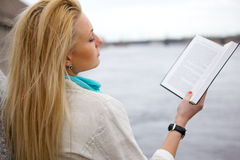 Girl with the book. Royalty Free Stock Photography