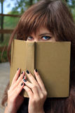 Girl with the book Royalty Free Stock Images