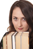 Girl with a book. Pensive girl reading a book isolated over white Stock Photography