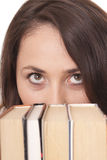 Girl with a book. Pensive girl reading a book isolated over white Royalty Free Stock Image