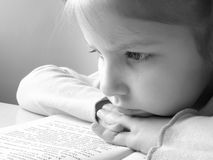 Girl with book 2. Small pretty reading girl black and white portrait Stock Photo