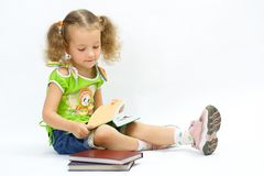 The girl with the book Royalty Free Stock Image