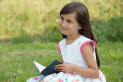 Girl with a book royalty free stock photos