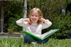 The girl with book Stock Photos