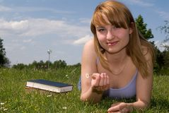 Girl with a book royalty free stock image