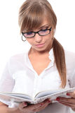 Girl with book. Close-up portrait of young beautiful woman with book Stock Photography