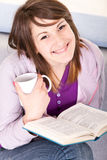 Girl with book anf coffee Stock Photography