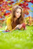 Girl with book in the autumn park Royalty Free Stock Images