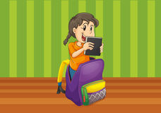 Girl with book in a bag Royalty Free Stock Photo