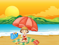 A girl with a book at the beach Royalty Free Stock Image