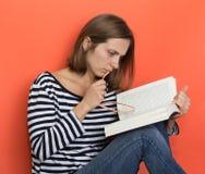 Girl with a book Stock Photos