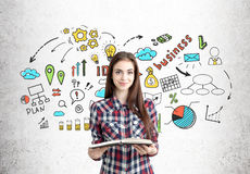 Girl with a book and business strategy Royalty Free Stock Image