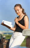 Girl with book dreaming. Young girl with book dreaming Stock Image
