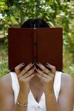 A girl with a book royalty free stock photos