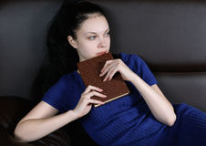 Girl with book in hand Stock Photos