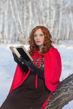 Girl with book in hand. Winter Stock Photography