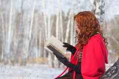 Girl with book in hand. Winter Stock Image