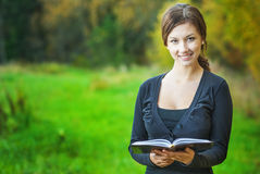 Girl with book in hands Royalty Free Stock Images