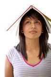 Girl with a book on her head Stock Photography