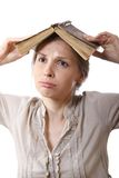 Girl with a book on her head Stock Images