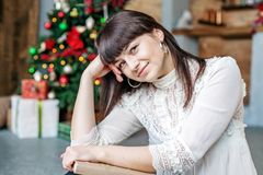 A girl with a book at home. Concept Happy Christmas, comfort, wi Royalty Free Stock Image